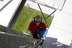 Paul Blevins, flagman for the 2003 Indianapolis 500, climbs up the ladder to his flag stand in preparation to give the green flag during a practice session