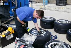 Team Menard crew member Trevor Mitchener prepares tires