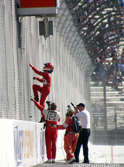 Helio Castroneves takes to the fence