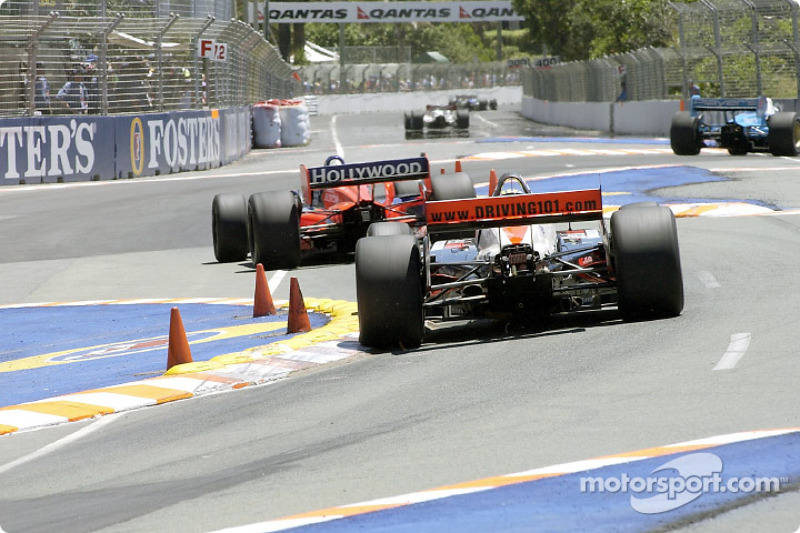 Tony Kanaan and Alex Barron in the chicane