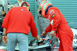 Ferrari drivers Michael Schumacher and Eddie Irvine congratulate the new Formula One World Champion Mika Hakkinen, McLaren