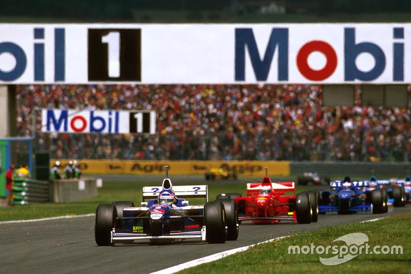 Jacques Villeneuve, Williams FW19 Renault; Michael Schumacher, Ferrari F310B; Olivier Panis, Prost JS45 Mugen Honda
