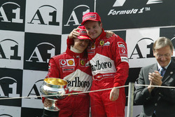 Podium: race winner Michael Schumacher, Ferrari, second place Rubens Barrichello, Ferrari