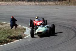 Masten Gregory, Lotus 18 Climax, leads Ricardo Rodriguez, Ferrari Dino 156