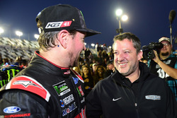 Kurt Busch, Stewart-Haas Racing Ford, celebrates in Victory Lane with team co-owner Tony Stewart after winning