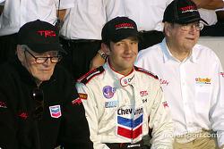 Cristiano da Matta celebrates 2002 CART Championship with Paul Newman and Carl Haas