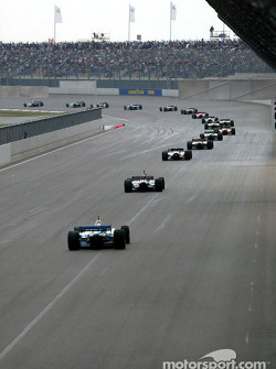 The field heads into turn 1