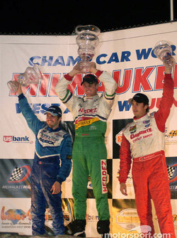Podium: race winner Ryan Hunter-Reay with Patrick Carpentier and Michel Jourdain Jr.