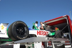 Ryan's car get unloaded from the trailer on Thursday morning