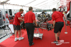 PKV Racing crew members assemble the car