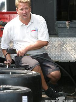 Newman/Hass Racing crew member prepares tires