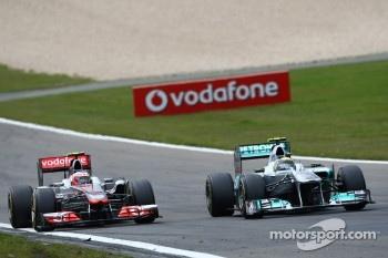 Jenson Button, McLaren Mercedes and Nico Rosberg, Mercedes GP F1 Team