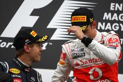 Podium: race winner Jenson Button, McLaren Mercedes, second place Sebastian Vettel, Red Bull Racing