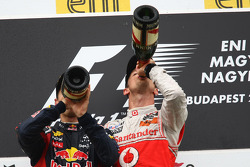 Podium: race winner Jenson Button, McLaren Mercedes, second place Sebastian Vettel, Red Bull Racing