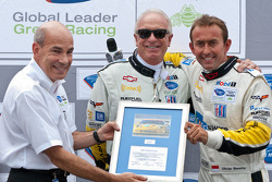 Olivier Beretta is presented with a plaque for his 100th race