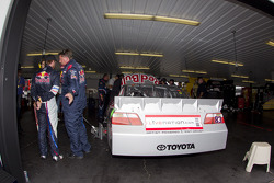 Brian Vickers, Red Bull Racing Team Toyota comes into the garage area due to a blown engine