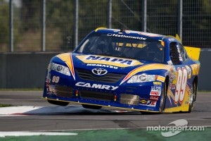 Patrick Carpentier bouncing over the kerbs in 2011