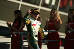 Valtteri Bottas celebrates victory in the race and winning the drivers championship on the podium