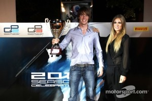 Nigel Melker, collects the trophy for 3rd in the GP3 drivers Championship
