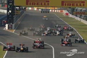 Button on the grass, Vettel leading the start