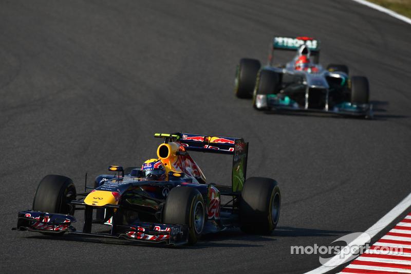 Mark Webber, Red Bull Racing leads Michael Schumacher, Mercedes GP F1 Team