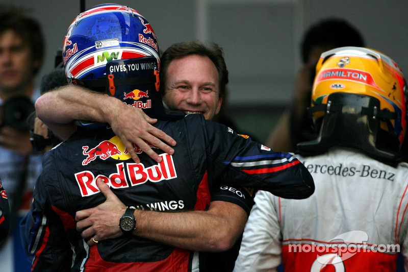 Third place Mark Webber, Red Bull Racing and second place Lewis Hamilton, McLaren Mercedes