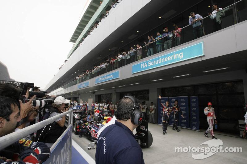 Sebastian Vettel, Red Bull Racing with Mark Webber, Red Bull Racing and Lewis Hamilton, McLaren Mercedes