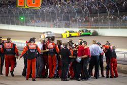 Stewart-Haas Racing Chevrolet team members celebrates as Tony Stewart wins the NASCAR Sprint Cup Series 2011 championship
