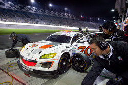 Pit stop for #70 SpeedSource Mazda RX-8: Jonathan Bomarito, Marino Franchitti, James Hinchcliffe, Sylvain Tremblay