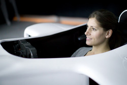 Cyndie Allemann tries the Base Performace race simulator in Tokyo