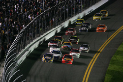 Martin Truex Jr., Michael Waltrip Racing Toyota and Jamie McMurray, Earnhardt Ganassi Racing Chevrolet lead the field