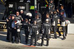 Turner Motorsports Chevrolet team members celebrate the victory of James Buescher
