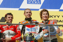 Podium: race winner Valentino Rossi, Repsol Honda Team, second place Loris Capirossi, Ducati Team, third place Nicky Hayden, Repsol Honda Team