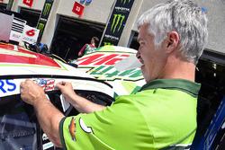 A Hendrick Motorsports places a Nicky Hayden decal on the car of Kasey Kahne, Hendrick Motorsports Chevrolet