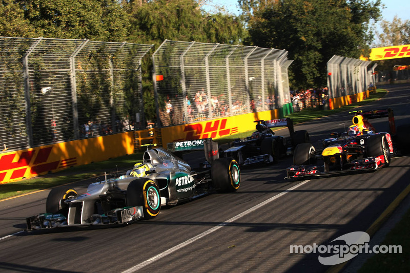 Nico Rosberg, Mercedes GP and Mark Webber, Red Bull Racing