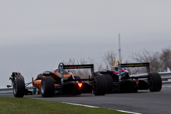 Carlos Sainz Jr. and Harry Ticknell battle