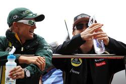 Heikki Kovalainen, Caterham F1 Team with Kimi Raikkonen, Lotus F1 Team on the drivers parade