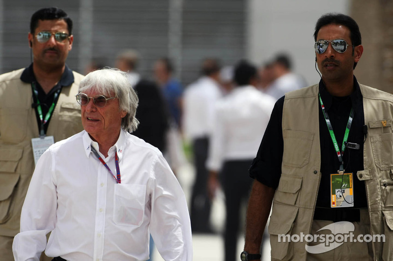 Bernie Ecclestone, CEO Formula One Group, with security