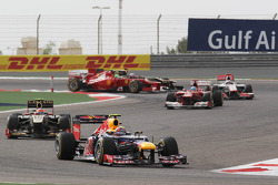 Mark Webber, Red Bull Racing leads Romain Grosjean, Lotus F1