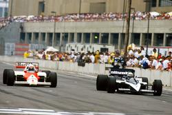 Alain Prost, McLaren MP4/2C-TAG Porsche, passes Riccardo Patrese, Brabham BT55-BMW