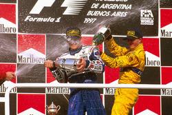 Podium: Race winner Jacques Villeneuve, Williams Renault, third place Ralf Schumacher, Jordan Peugeot