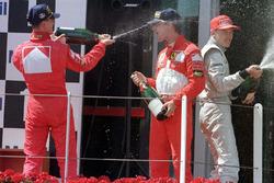 Подиум: победитель Михаэль Шумахер, второе место – Эдди Ирвайн, Ferrari, третье место – Мика Хаккинен, McLaren