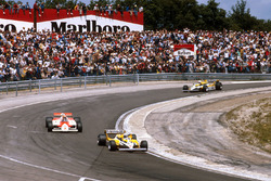 Alain Prost, Renault RE30 leads John Watson, McLaren MP4/1 Ford, René Arnoux, Renault RE30
