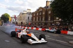 Stoffel Vandoorne, McLaren, takes a McLaren MP4/6 around as Valtteri Bottas, Mercedes AMG F1 W08, displays