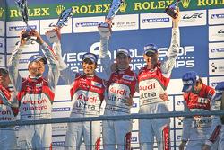 LMP1 Podium: race winners, Romain Dumas, Loic Duval, Marc Gene; second place, Allan McNish, Tom Kristensen, Rinaldo Capello; third place, Oliver Jarvis, Marco Bonanomi