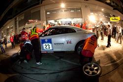 Pit stop for #23 Team Nissan GT-R Nissan GT-R: Toshio Suzuki, Tetsuya Tanaka, Kazuki Hoshino, Michael Krumm