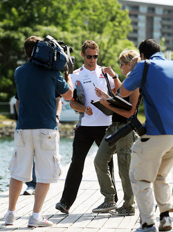 Jenson Button, McLaren Mercedes signs autographs for the fans
