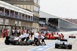 Lewis Hamilton, McLaren Mercedes passes Nico Rosberg, Mercedes AMG F1 and Felipe Massa, Scuderia Ferrari in the pits