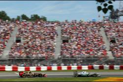Nico Rosberg, Mercedes GP and Romain Grosjean, Lotus F1 Team