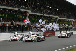 #1 Audi Sport Team Joest Audi R18 E-Tron Quattro: Marcel Fässler, Andre Lotterer, Benoit Tréluyer takes the checkered flag in front of #2 Audi Sport Team Joest Audi R18 E-Tron Quattro: Rinaldo Capello, Tom Kristensen, Allan McNish